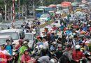 Tin trong nước - Chùm ảnh: Đường phố Sài Gòn thành sông, giao thông tê liệt
