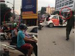 Tài xế taxi leo lên nóc xe ăn vạ, kêu nhiễm HIV khi bị CST dừng xe