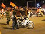 Ngồi trên nóc ôtô cầm cờ cổ vũ Olympic Việt Nam sẽ bị xử lý nghiêm