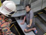 Malaysia: Xót xa người đàn ông bị thang cuốn