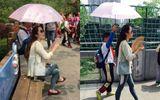 Trung Quốc: Học sinh cầm ô che nắng cho cô suốt buổi dã ngoại