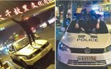 Thanh niên nghịch dại live-stream trên mui xe cảnh sát và cái kết không có hậu