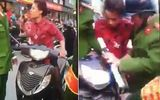 Hà Nội: Bị dừng xe, người phụ nữ đi SH chửi bới, đạp cảnh sát giữa đường