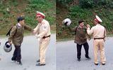Bị dừng xe, người vi phạm giao thông cầm mũ bảo hiểm dọa CSGT