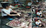 Bán thịt lợn giá rẻ, người phụ nữ bị hắt dầu luyn trộn chất thải