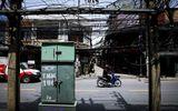 24h qua ảnh: Dây điện chằng chịt như mạng nhện ở Bangkok