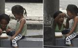 Nghẹn lòng hình ảnh anh trai ăn xin xúc từng thìa cơm cho em gái