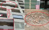 Hoảng hồn vì mảng tường lớn từ tầng 7 chung cư rơi xuống