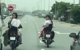 Nhóm thanh niên đầu trần, dàn hàng chặn xe trên quốc lộ để rước dâu gây bức xúc