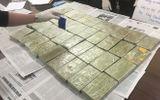 """Hà Nội: Phá đường dây vận chuyển ma túy """"khủng"""", thu giữ 39 bánh heroin"""