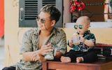 Bố và em bé cùng đeo kính đen