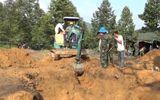 Đào đất trồng sầu riêng, phát hiện 9 bộ hài cốt liệt sĩ