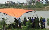 Thi thể phụ nữ đang phân hủy trôi sông sáng mùng 3 Tết