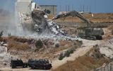 Israel phá hủy hàng trăm ngôi nhà của người Palestine gần Bờ Tây