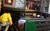 """Video: """"Căng não"""" theo dõi người dân giải cứu bé gái 5 tuổi bị bố lôi vào gầm tàu để tự tử"""