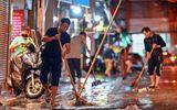 Tin trong nước - Mưa lớn kinh hoàng đêm 30 Tết, người dân Thủ đô hối hả dọn nhà ngập nước kịp đón giao thừa