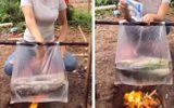 """Dùng túi nilon nấu cá cực điệu nghệ, cô gái khiến dân mạng """"tròn mắt"""" ngạc nhiên"""