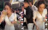 Cô dâu thay chồng uống cạn 3 cốc bia để nhận tiền mừng cưới từ hội bạn
