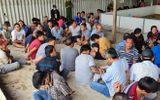 """Hơn 100 cảnh sát phá sòng bạc trong kho gạo bỏ hoang: Bắt 153 """"con bạc"""", thu gần 2 tỷ"""