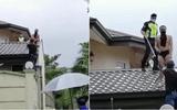 Tên trộm bị chó dọa trốn lên tận mái nhà, tình cảnh lúc bị bắt không thể thê thảm hơn