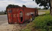 Nam công nhân lái máy nâng tử vong trong tư thế treo cổ bên thùng xe container