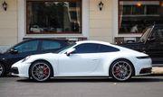 Vợ chồng Cường Đô La dạo phố bằng siêu xe Porsche 911 Carrera S giá gần 8 tỷ