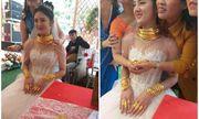 Hé lộ danh tính cô dâu đeo vàng