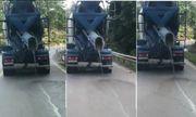 Phẫn nộ xe trộn bê tông vừa đi vừa rải chất thải xuống đường