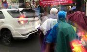 Sáng 12/5, phụ huynh Hà Nội đội mưa, nhích từng mét đưa con đến trường
