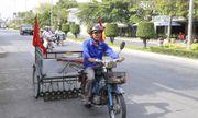Người đàn ông cần mẫn đội nắng hút đinh trên đường tại An Giang