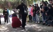 Vụ clip thiếu nữ mặc áo đỏ bị cô gái áo đen đánh dã man: Người đánh là ai?