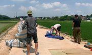 Sau cuộc đối thoại, người dân ngừng chặn xe chở rác vào bãi rác Nam Sơn