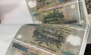 Vụ triệt phá điểm sản xuất tiền giả ở Cần Thơ: Thu giữ máy móc, các khổ giấy in hình tiền