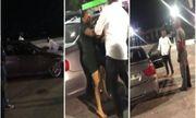 Video: Bị bạn gái chia tay, người đàn ông bám trên nắp ca-pô xe BMW, quyết