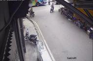 Ôtô - Xe máy - Video: Băng qua đường trước mũi xe container, hai mẹ con thoát chết trong gang tấc
