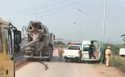 Truy tìm ô tô 16 chỗ hất CSGT xuống khỏi xe, bỏ chạy trên cao tốc Hà Nội - Bắc Giang - ảnh 1