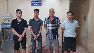 """Bắt ổ nhóm cho vay lãi """"cắt cổ"""" 365%/năm ở Hà Nội, thu giữ cả bao tải vũ khí - ảnh 1"""