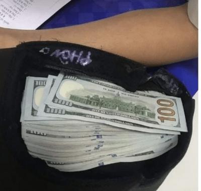 Khách Trung Quốc quên túi xách chứa cả chục nghìn USD ở sân bay - ảnh 1