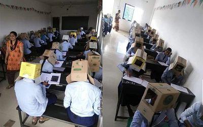 Giáo viên bắt học sinh đội thùng carton lên đầu để chống gian lận khiến nhiều người tức giận - ảnh 1
