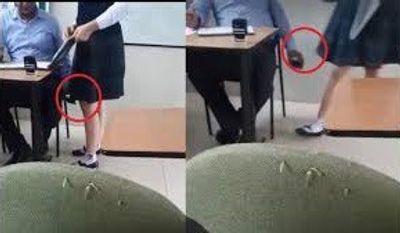 Xôn xao clip thầy giáo vừa chấm bài vừa quay lén dưới váy nữ sinh - ảnh 1