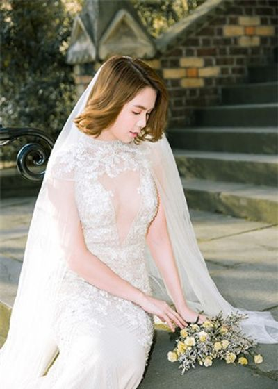 Ngọc Trinh diện váy cưới đẹp lộng lẫy gây bất ngờ - ảnh 1