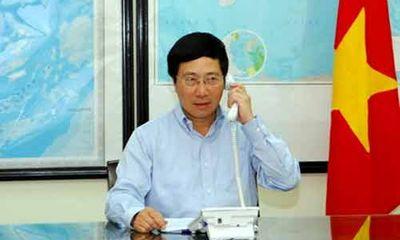 Phó Thủ tướng Phạm Bình Minh điện đàm với Ủy viên Quốc vụ TQ
