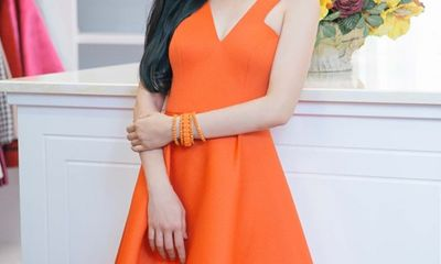 Lệ Quyên rạng rỡ sắc cam trước ngày mang Q-Show sang Mỹ
