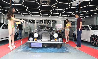 Đi rửa xe giá 3 triệu đồng 2 lần/ngày để ngắm chân dài mặc bikini
