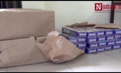 TP.HCM: Bắt 3.700 gói thuốc lá lậu chở trên xe 7 chỗ