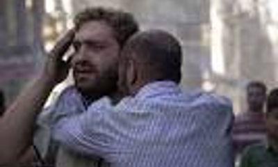 Ông bố Aleppo phát điên bên thi thể con trai