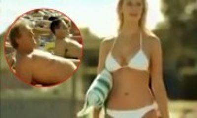 Bị vợ tát tai vì dám nhìn gái đẹp bikini trên bãi biển