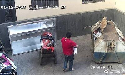 Cha nhẫn tâm ném đứa con chưa cắt dây rốn vào thùng rác