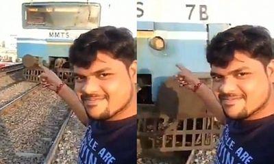 Khủng khiếp cảnh bị đoàn tàu đâm bay khi đang chụp ảnh tự sướng
