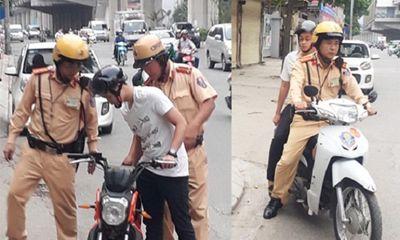Chiến sĩ CSGT Hà Nội đưa thí sinh bị hỏng xe đến tận điểm thi